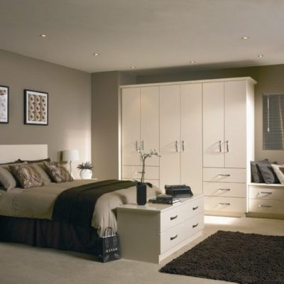 white bedroom with gray bed