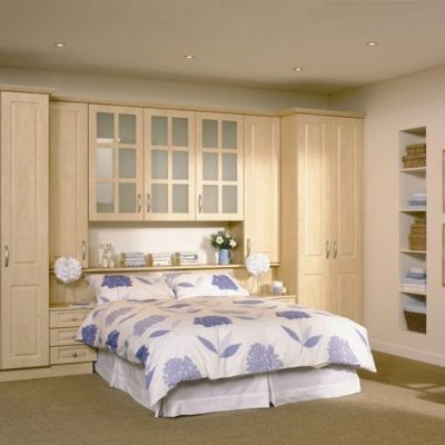 light wood double wardrobe around bed