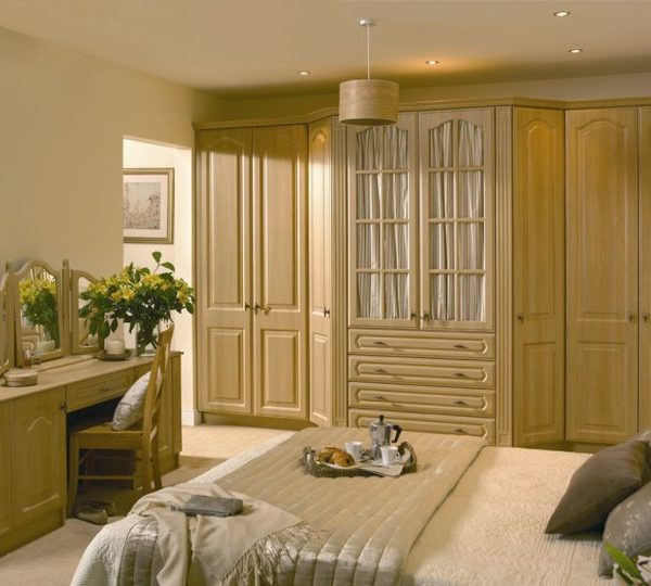 fitted wardrobes with tea on the bed